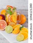 citrus fruit and herbs water... | Shutterstock . vector #1046121280