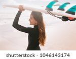 surfer girl looking on the... | Shutterstock . vector #1046143174