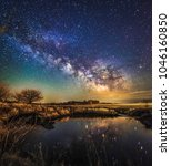 Small photo of Milkyway galaxy and its reflection over an Iowan pond