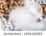sugar on white table in bowl.... | Shutterstock . vector #1046163583