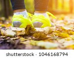 the girl is walking on road in... | Shutterstock . vector #1046168794