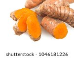 turmeric root and some slices... | Shutterstock . vector #1046181226