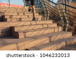 male athlete climbing up the... | Shutterstock . vector #1046232013