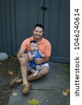 a father laughs and interacts...   Shutterstock . vector #1046240614