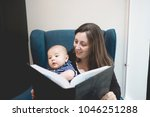 mother reading a book to her...   Shutterstock . vector #1046251288