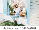 graceful happy girl sitting on... | Shutterstock . vector #1046269390