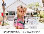 romantic girl in pink attire... | Shutterstock . vector #1046269444