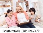 beautiful grandmother looks at... | Shutterstock . vector #1046269570