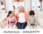 joyful grandmother with... | Shutterstock . vector #1046269579