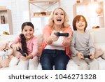 joyful grandmother with... | Shutterstock . vector #1046271328