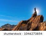 businessmen stand on high peaks ... | Shutterstock . vector #1046273854