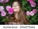 beautiful woman in flowers | Shutterstock . vector #1046275666