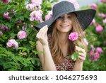 beautiful woman in flowers | Shutterstock . vector #1046275693