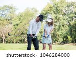 asian young couple playing golf ... | Shutterstock . vector #1046284000