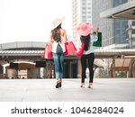 back view of young women with... | Shutterstock . vector #1046284024