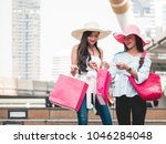 happy young women with shopping ... | Shutterstock . vector #1046284048