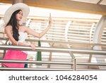 beautiful young woman making... | Shutterstock . vector #1046284054