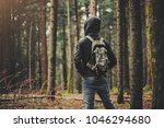 young hooded man hiking in the... | Shutterstock . vector #1046294680