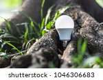 led bulb in the forest nature...   Shutterstock . vector #1046306683