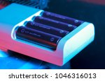 rechargeable battery being... | Shutterstock . vector #1046316013