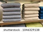 piles of towels on a shelves | Shutterstock . vector #1046329138