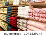 piles of towels on a shelves | Shutterstock . vector #1046329144