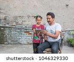 an unidentified person helps an ...   Shutterstock . vector #1046329330