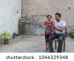 an unidentified person helps an ...   Shutterstock . vector #1046329348