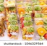 fresh sliced fruits in plastic... | Shutterstock . vector #1046329564