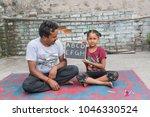 unidentified person in ludhiana ...   Shutterstock . vector #1046330524