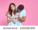 young couple in white t...   Shutterstock . vector #1046382400