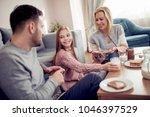 family of three having... | Shutterstock . vector #1046397529
