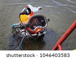 military diver for his work, he is looking for hidden mines on the bottom of the river with a special device mine detector