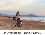 healthy lifestyle by the sea.... | Shutterstock . vector #1046413990