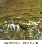 full frame detail of a small stony stream in Southern Germany, small focus - stock photo