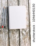 Small photo of Notepad with pencils mocap. Place for text