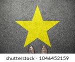 big yellow star on floor with... | Shutterstock . vector #1046452159