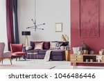 red armchair next to a purple... | Shutterstock . vector #1046486446