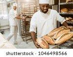 handsome african american baker ... | Shutterstock . vector #1046498566