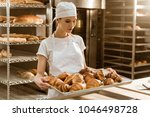 attractive female baker holding ... | Shutterstock . vector #1046498728