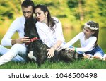 happy family with pet dog at... | Shutterstock . vector #1046500498