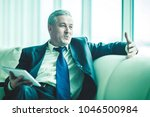 successful businessman with... | Shutterstock . vector #1046500984