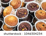 cupcakes and muffins on the... | Shutterstock . vector #1046504254