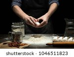 hands are cracking an egg into... | Shutterstock . vector #1046511823