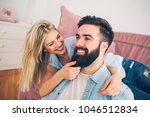 happy modern young couple... | Shutterstock . vector #1046512834