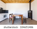 Room With Table And Wood Stove  ...