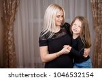 portrait beautiful mother and...   Shutterstock . vector #1046532154