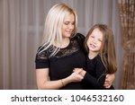 portrait beautiful mother and...   Shutterstock . vector #1046532160