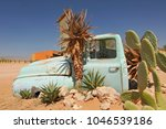 old and rusty car wreck at the... | Shutterstock . vector #1046539186