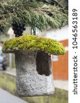Moss Covered Stone Birdhouse